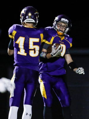 Two Rivers' Carson Koch (9) celebrates with teammate Will Schmid (15) after scoring a touchdown against Kiel during their homecoming game Sept. 29 in Two Rivers.
