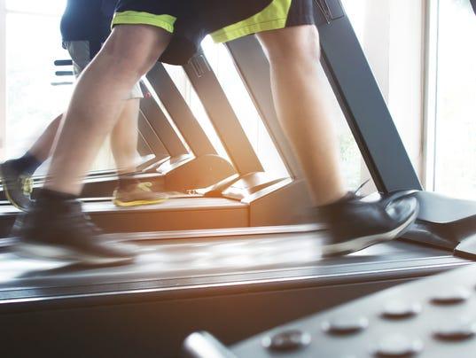 People running on treadmill machine.