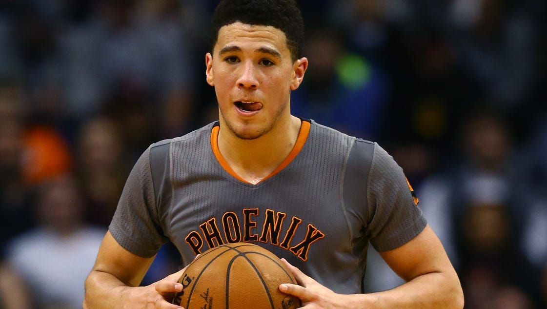 The Suns on Saturday signed guard Devin Booker to a fiveyear 158 million contract extension