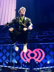 Andrew Taggart of The Chainsmokers catches some air