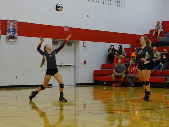 Addison Ackerman of Buckeye Central hits her serve