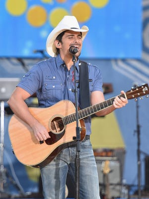 """NEW YORK, NY - AUGUST 29:  Singer/songwriter Brad Paisley performs on ABC's """"Good Morning America"""" at Rumsey Playfield, Central Park on August 29, 2014 in New York City.  (Photo by Mike Coppola/Getty Images)"""