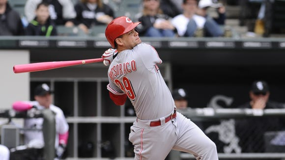 Reds' Devin Mesoraco hits an RBI triple against the