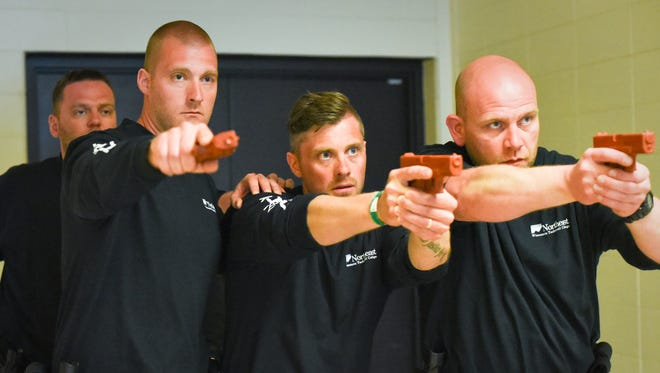 Icelandic police officers Grimur Thor, Ragnar Gudmundsson, Gunnar Einarsson and Olafur Olafsson participate in active-shooter training Friday at West De Pere High School.