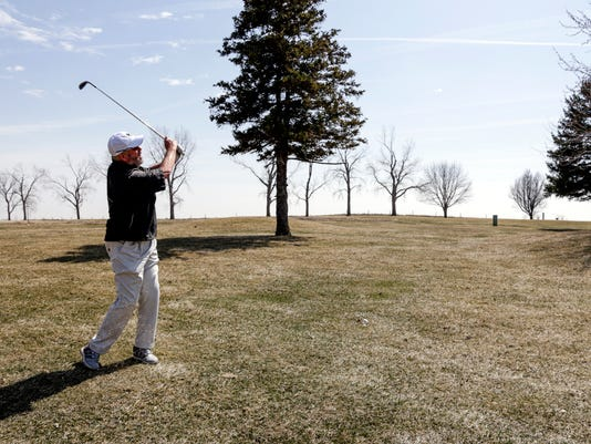 In this April 5, 2018 photo, Bellevue University golf team member Don Byers swings during practice at the Platteview Golf Club in Bellevue, Neb. 61-year-old Byers is the oldest athlete in the NAIA since Alan Moore kicked an extra point for Faulkner University of Alabama when he was 61 in 2011. (AP Photo/Nati Harnik)