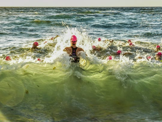 Loggerhead Triathlon swimmers in wave action