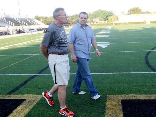 Shawn Berner, a Bishop Verot graduate, talks with his former coach, Bill Shields, while visiting the highschool on Friday. Berner was the head football coach at Fort Campbell High School in Kentucky for 11 years.
