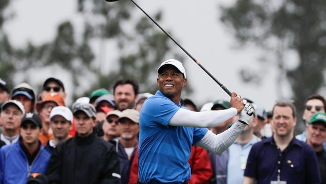 Tiger Woods hits a drive on the eighth hole during the third round at the Masters golf tournament Saturday in Augusta, Ga.