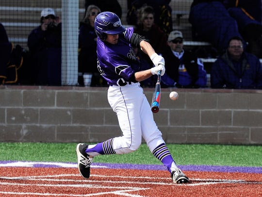 Wylie third baseman Jaxon Hansen (39) makes contact