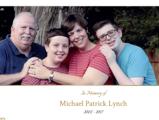 Michael Lynch, 14, right, pictured with his family.