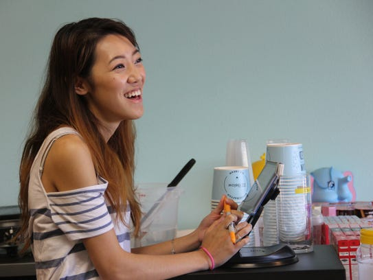 Kady Chen greets a customer at her new ice cream shop