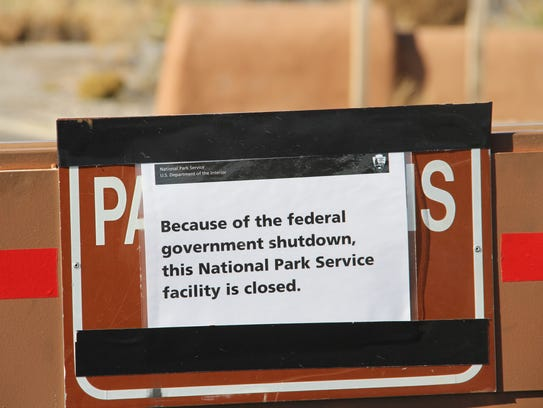One of several signs posted at the entrance to  White