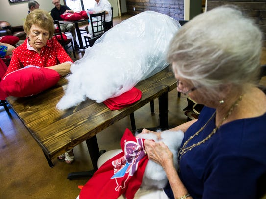 Pat Coplin, left, and Betty Linebaugh stuff pillows