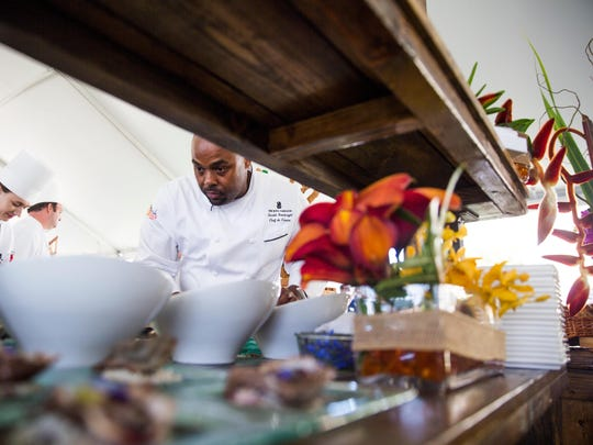 Gerald Sombright, Chef de Cuisine at the Ritz-Carlton on Marco Island, prepares oysters during the 2017 auction.