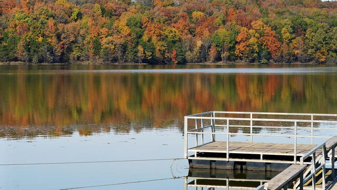 Changing leaves around Lake Alma add a colorful view from the pier Wednesday, Nov. 5, 2020. Peak fall foliage usually occurs the first weekend of November for the River Valley.