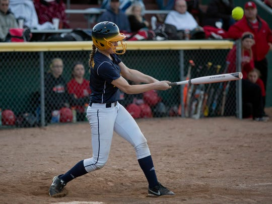 Northern's Riley Snowden gets a hit during a softball game Friday, May 1, 2015 at Port Huron High School.