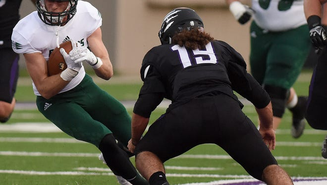 Bemidji State's Vince Dinkel carries the ball while USF's Kyle Campiotti defends at Bob Young Field on Saturday. Campiotti came to USF from Chabot College in Hayward, Calif.
