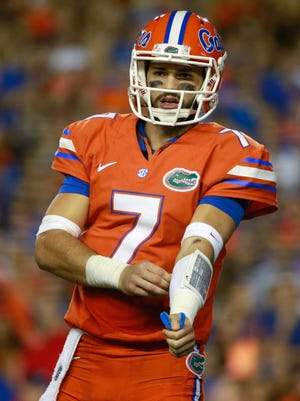 Florida Gators quarterback Will Grier (7) against the Mississippi Rebels  during the first half at Ben Hill Griffin Stadium.