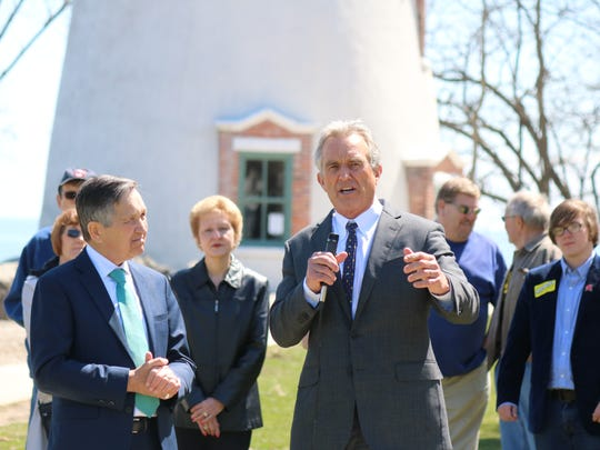 Dennis Kucinich, left, and joins environmental advocate Robert F. Kennedy Jr. in promoting Lake Erie water quality in a stop at the Marblehead Lighthouse on Thursday.