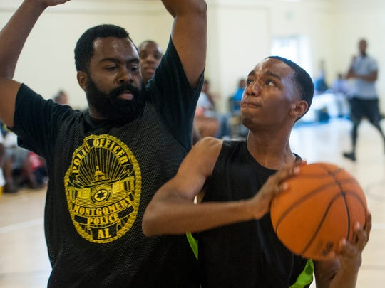 Maggie Street Missionary Baptist Church youth play Montgomery Police Officers in a game of basketball at the church in Montgomery, Ala., on Saturday July 23, 2016.
