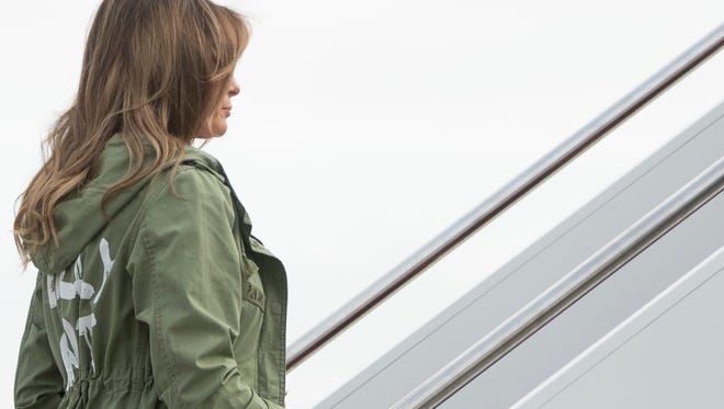 First lady Melania Trump boards a plane at Andrews Air Force Base, Md., June 21, 2018, to travel to Texas. The writing on her jacket raised eyebrows.