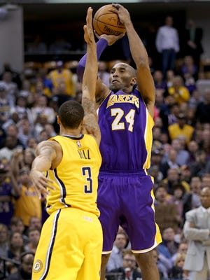 Los Angeles Lakers forward Kobe Bryant (24) hits one of his three-point shots over Indiana Pacers guard George Hill (3) in the second half of their game. The Indiana Pacers host the Los Angeles Lakers Monday, Feb8, 2016, evening at Bankers Life Fieldhouse. The Pacers defeated the Lakers 89-87.