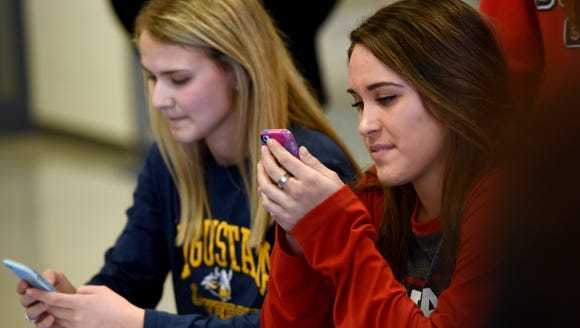 O'Gorman's Theresa Pujado and Isabelle Hedge look at