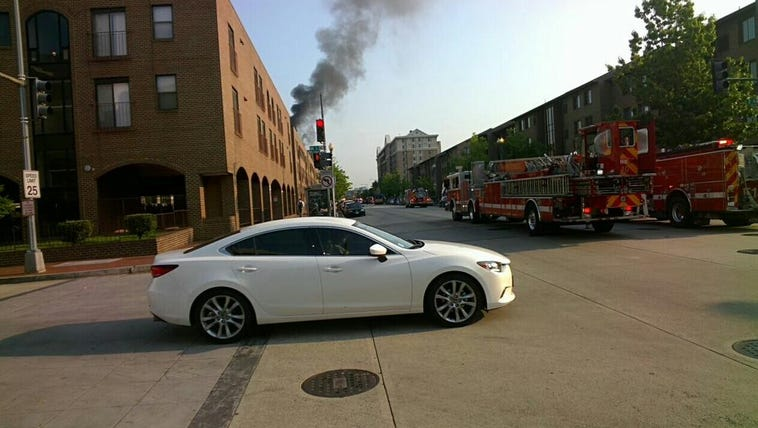 View from street of 7th St NW apartment building fire