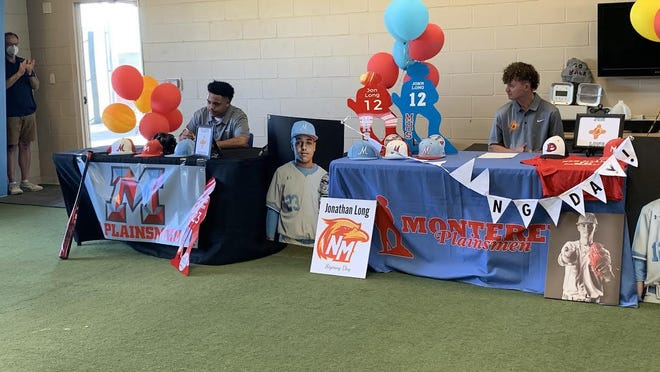 Monterey first baseman Braden Benton (left) signs his national letter of intent to continue his baseball career at New Mexico Junior College on Tuesday at Moegle Field. He and Jon Long (right) will continue to be teammates as the Plainsman pitcher also signed with the Thunderbirds baseball program.