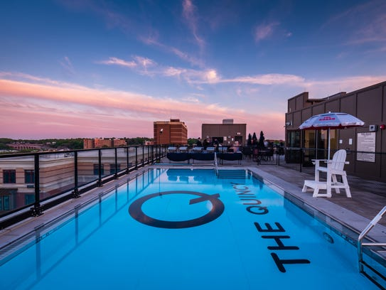 The rooftop pool at the Quincy has a bar for parties, large-screen television, deck chairs and panoramic views of the city, Rutgers University and the Raritan River.