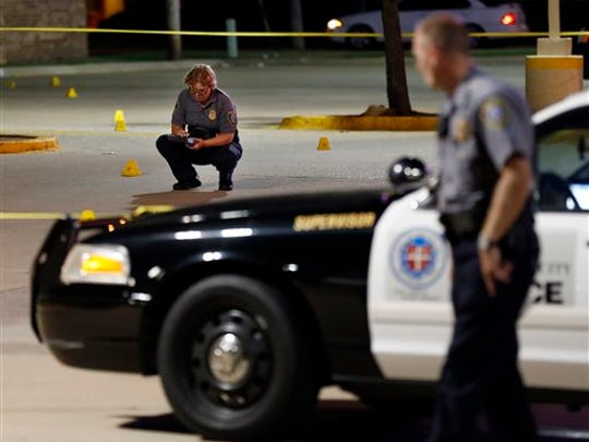 Police investigate the scene where Oklahoma Labor Commissioner Mark Costello was fatally stabbed, Sunday, Aug. 23, 2015, in Oklahoma City. Christian Costello, son of Mark Costello, was arrested on a first-degree murder complaint, police said.