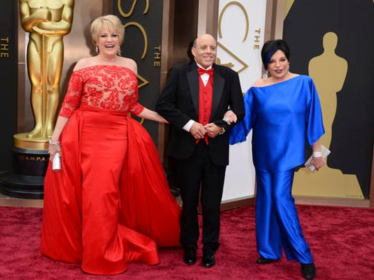 FILE - This March 2, 2014 file photo shows the children of Judy Garland, from left, Lorna Luft, Joseph Luft and Liza Minnelli at the Oscars in Los Angeles. Representatives for a cemetery and the family of Garland say her remains have been moved from New York to a Los Angeles mausoleum. Garland's three children, including actress Liza Minnelli, live in Southern California and wanted to have Garland resting near them, Noelle Berman, a Hollywood Forever spokeswoman, told The Associated Press.