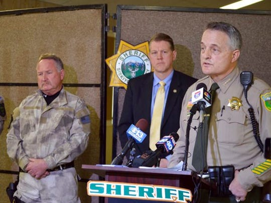 Siskiyou County Sheriff Jon Lopey, right, speaks during a press conference in Yreka on Thursday, April 20, 2017. A 15-year-old Tennessee girl was rescued near a cabin in a remote part of Northern California on Thursday, April 20, 2017, more than a month after her 50-year-old teacher kidnapped her and set off a nationwide manhunt, authorities said.