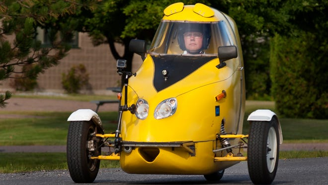 Paul Smith takes to Leroy Road in Williston in his single-seater ScooterCar.