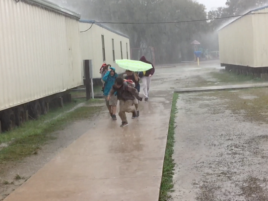 Students battle the elements running to their next class, which causes them to stay soaked all day.