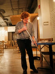 Joan Hutchinson sweeps the restaurant floor at Rye