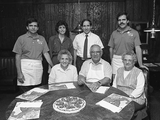 Members of the DeLuca family at the restaurant. Back: Chuck DeLuca, Sue Naccarato, John DeLuca and Tom DeLuca; seated, Louise Coscarelli, Pat DeLuca and Helen (Lena) DeLuca, April 14, 1987.