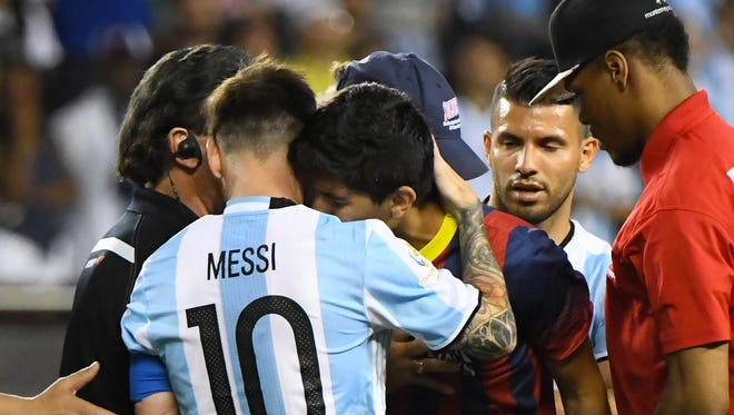 Argentina midfielder Lionel Messi (10) hugs Perry's David Cardenas as the Class 2A All-Iowa forward is arrested for running onto the field after the game during a Copa America Centenario group D soccer match between Argentina and Panama on Friday, June 10, 2016, in Chicago.