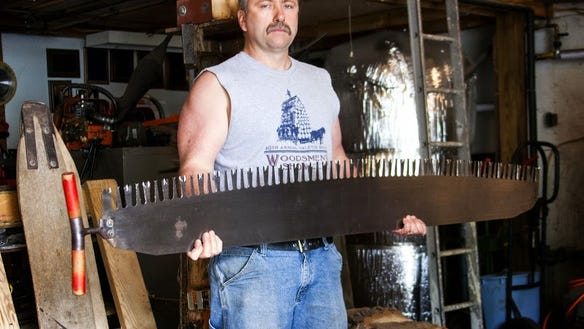Paul Pfenninger in his shop with one of his completed saws.
