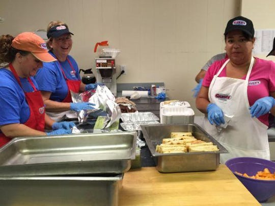 Staff working the kitchen at the California Giant fundraiser.