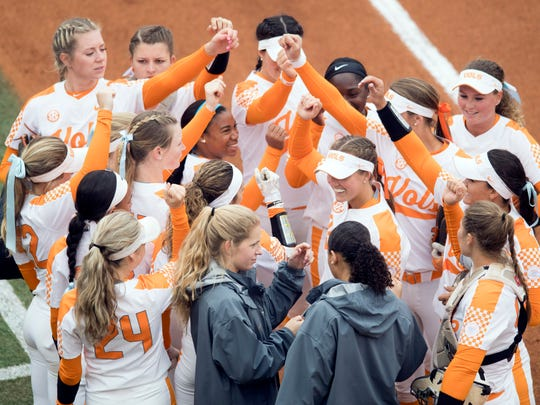 The Tennessee softball team gather between innings during the game against Missouri on Sunday, March 11, 2018.