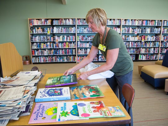 Kay Tannatt sets out books for the Storybook Project, a volunteer program that keeps incarcerated parents and their children connected through reading at the Iowa Correctional Institution for Women in Mitchellville Tuesday, April 11, 2017.