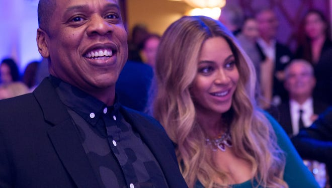 Jay Z and Beyonce dressed to kill.