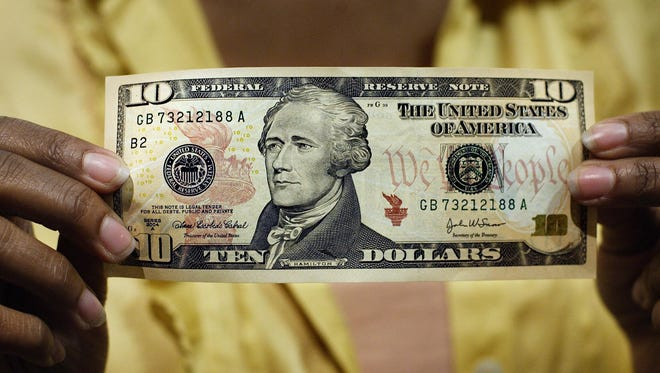 In this March 2, 2006 file photo, a $10 bill, featuring a likeness of Andrew Hamilton, the first U.S. Treasury secretary, is displayed at the National Archives gift shop, in Washington.