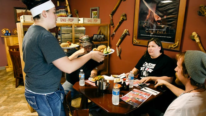 Brandi Riedemann, left to right, serves lunch to Rich Kieffer, Dawn Monson and Thomas Hunt, all from Pierz, on Tuesday, March 8, at the Wonton Chinese Restaurant in Foley.