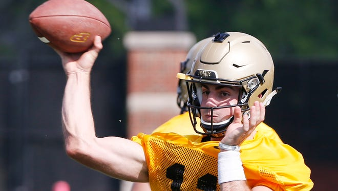 Quarterback David Blough with a pass during football practice Thursday, August 4, 2016, at the Bimel Practice Complex on the campus of Purdue University.