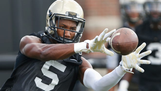 Wide receiver Domonique Young with a pass reception during football practice Thursday, August 4, 2016, at the Bimel Practice Complex on the campus of Purdue University.