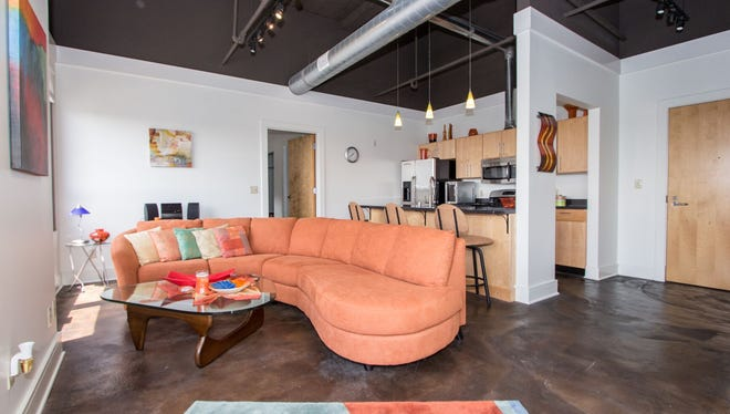 A living room of one unit at the Lofts at Artspace.