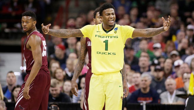 Oregon forward Jordan Bell (1) celebrates during the second half of a second-round men's college basketball game against Saint Joseph's in the NCAA Tournament in Spokane, Wash., Sunday, March 20, 2016. Oregon won 69-64. (AP Photo/Young Kwak)