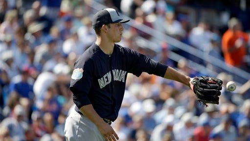 New York Yankees pitcher James Kaprielian catches a ball on the mound during the fifth inning of an exhibition spring training baseball game against the New York Mets Wednesday, March 9, 2016, in Port St. Lucie, Fla. (AP Photo/Jeff Roberson)